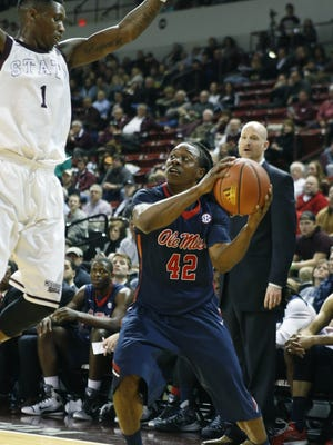 Mississippi guard Stefan Moody (42) looks to pass around Mississippi State guard Fred Thomas in the second half at an NCAA college basketball game in Starkville, Miss., Thursday, Feb. 19, 2015. Mississippi won 71-65. (AP Photo/Rogelio V. Solis)