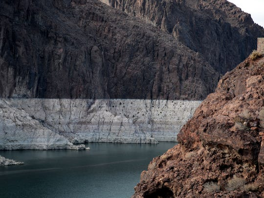 "As Lake Mead has declined, a white ""bathtub ring"" has"