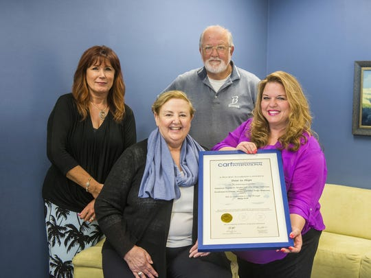Door to Hope receives accreditation. Front row, from left: Chris Shannon, Executive Director and Kathy Burrola, MFT, Clinical Director. Back row, from left: Valerie Catania, Quality Manager and John De Miranda, Ed. M., LAADC, Associate Director.