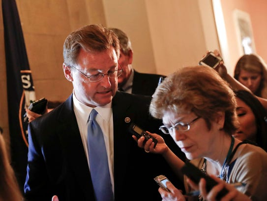 Sen. Dean Heller, R-Nev. speaks to members of the media