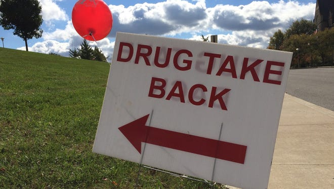 A sign points toward a Prescription Drug Take-Back Day collection at Richmond Police Department.