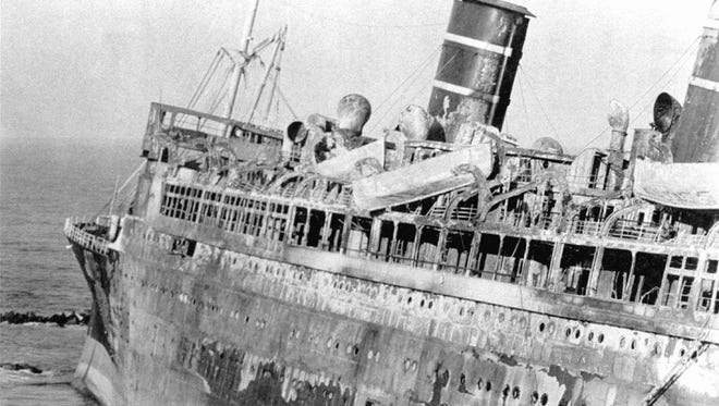 Lifeboats still hang from the scorched decks of the S.S. Morro Castle, which reflect how little time its passengers and crew had to abandon ship as fire swept through the vessel on Sept. 8, 1934.