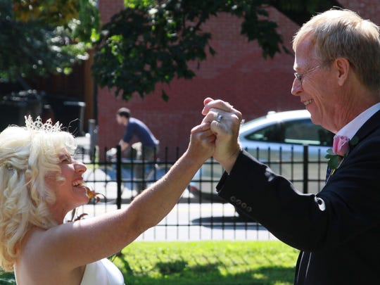 Tina Brigham and Steve Carlsen are united in marriage outside at the Ronald McDonald House in Burlington.