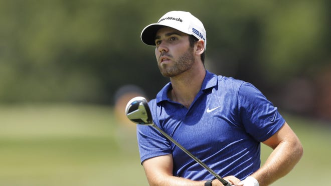 Matthew Wolff watches his drives on the second tee during the third round of the Rocket Mortgage Classic golf tournament Saturday at the Detroit Golf Club in Detroit.