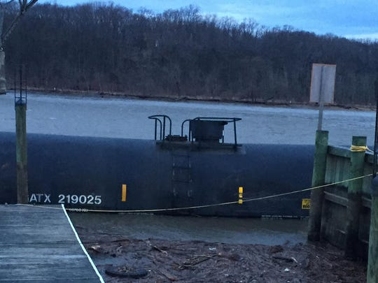 A CSX tanker car floats along a dock in Perryville after it was apparently blown off the train bridge between Cecil and Harford counties during Friday's storm. The tanker was one of four cars that fell from the train into the Susquehanna River.