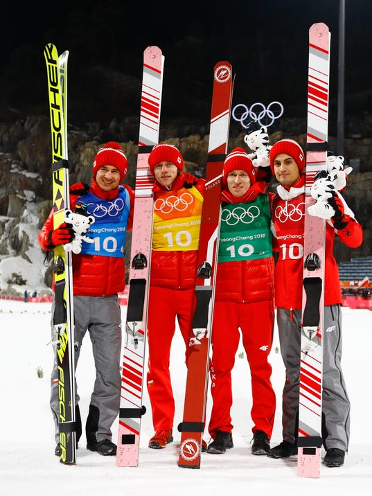 Poland poses after winning the bronze medal during the men's large hill team ski jumping competition at the 2018 Winter Olympics in Pyeongchang, South Korea, Monday, Feb. 19, 2018. (AP Photo/Kirsty Wigglesworth)