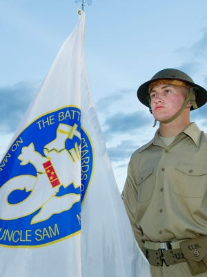 New Mexico State University ROTC member Ryan McCarty displays the Bataan Battling Bastards flag during opening ceremonies for the 29th Bataan Memorial Death March held Sunday, March 25, 2018, at White Sands Missile Range.