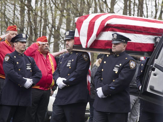 The casket of Marine Private First Class Robert Graham is carried into St. Elizabeth Ann Seton Church by members of the New York City Police Department on Friday, April 26, 2019 in Shrub Oak, NY.