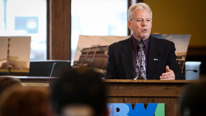 Lansing Board of Water & Light General Manager Dick Peffley announces the utility's plans for a natural gas-powered plant during a press conference on Monday, Dec. 18, 2017.