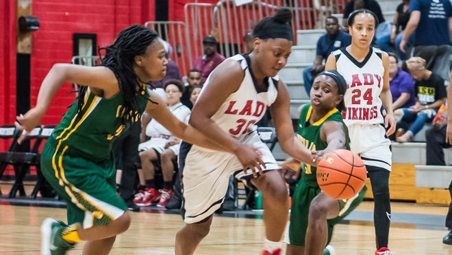 Northside's Brittney Smith (30)  forces the ball up court as the Northside girls basketball team plays Cecilia Thursday Feb. 15, 2018.