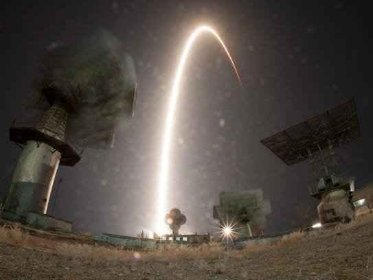 A long exposure shows the Soyuz-FG rocket booster with