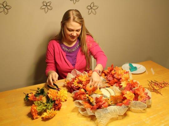 Glitter & Glue Girl Jyl Hall crafts a unique and festive autumn wreath.