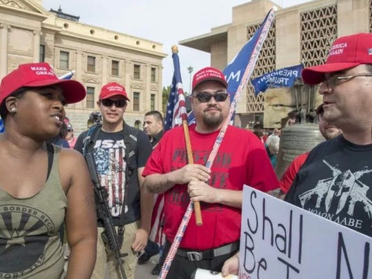 Dozens of pro-gun supporters, some carrying weapons, also attended the March for Our Lives rally at the Arizona State Capitol in Phoenix on Mach 24, 2018.
