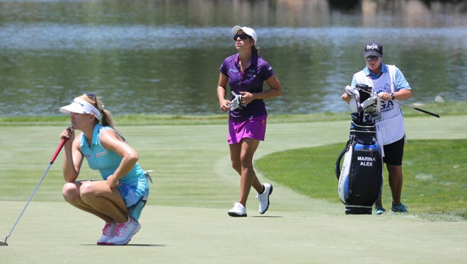 Marina Alex, center, had a down day, shooting an 80 on Saturday after rounds of 73 and 73. One of her round's few highlights came on the West Course's low point: The par-4 8th hole, where Alex holed out a shot from the greenside bunker.
