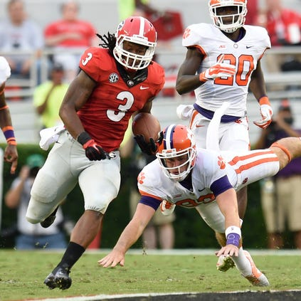 Georgia Bulldogs running back Todd Gurley (3) returns a kickoff for a touchdown against the Clemson Tigers.