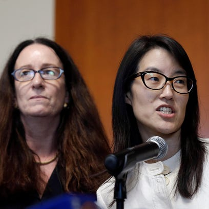 Ellen Pao, right, gives a statement to reporters next