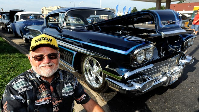 Ron Barclay, 77, of Gilberts, Illinois, poses with his 1958 Pontiac Bonneville.