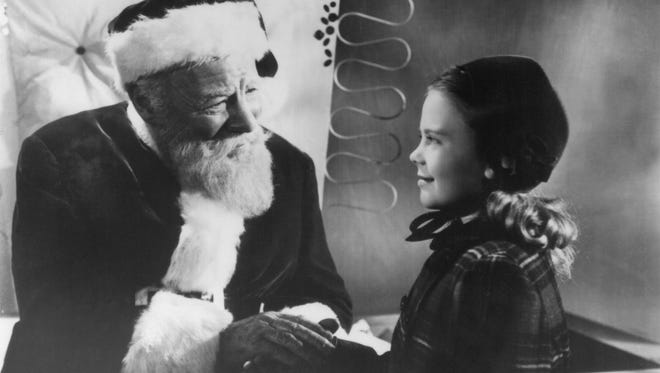 """Edmund Gwenn as Kris Kringle and Natalie Wood as Susan Walker in 1947's """"Miracle on 34th Street."""" The holiday favorite has been turned into a stage show."""