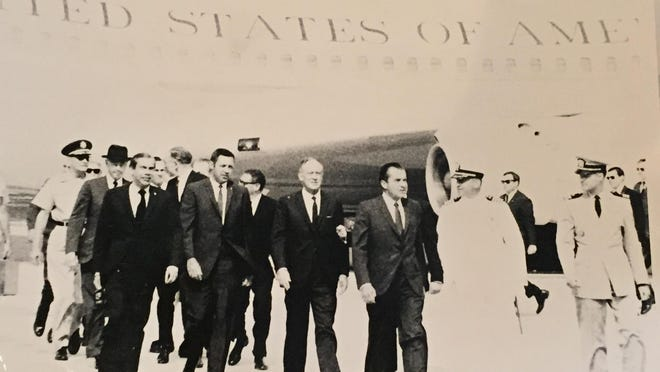 President Richard Nixon arrives on Midway Island on June 8, 1969. Air Force One can be seen in the background.
