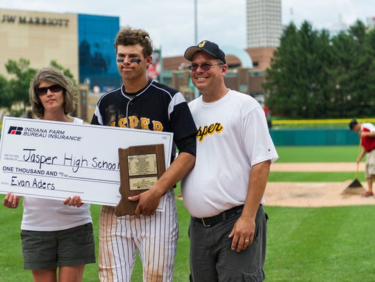 Former Jasper standout Evan Aders stands next to his parents, Pam and Doug, after winning the Mental Attitude Award following the Class 3A state championship game in June 2017 in Indianapolis.