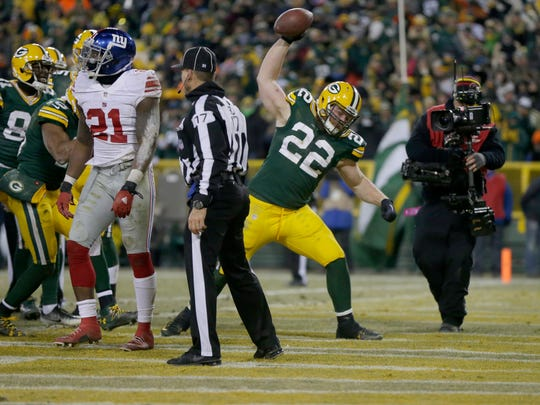 PACKERS09 PACKERS  -Green Bay Packers fullback Aaron Ripkowski (22) scores a touchdown against the New York Giants at Lambeau Field in Green Bay, Wis. on Sunday, January 8, 2017.