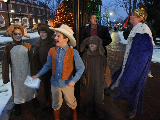 """The cast members from the The Children's Theatre of Dover and Kent County walking through downtown Dover to promote their play """"Night at the Wax Museum"""" at The Schwartz Center for the Arts."""