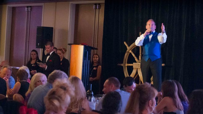 A live auction keeps audience engaged at the annual Wanderlust travel and culinary gala benefiting resort and hospitality management studies at Florida Gulf Coast University.