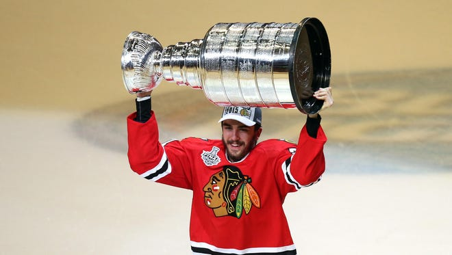 Middletown's Trevor van Riemsdyk of the Chicago Blackhawks celebrates with the Stanley Cup on Monday.