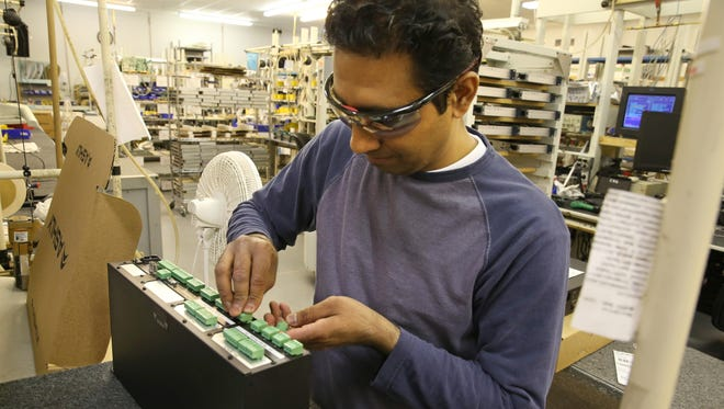 Selwyn Lal of Webster prepares a finished signal processor for shipping in the packaging area at Ashly Audio in Webster Wednesday, March 2, 2016.