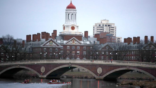 Rowers paddle down the Charles River near the campus of Harvard University in Cambridge, Mass., Tuesday, March 7, 2017.