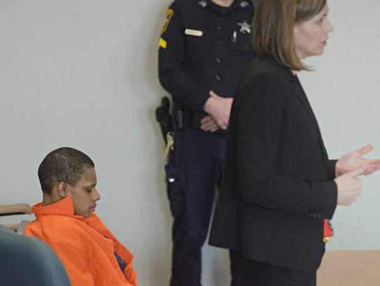Suspect Ashley Martin sits quietly in court Friday,