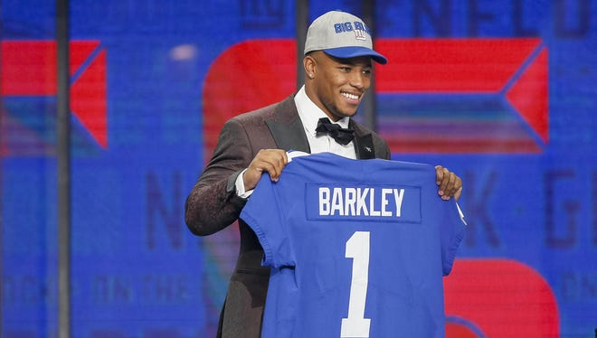 Saquon Barkley (Penn State) is selected as the number two overall pick to the New York Giants in the first round of the 2018 NFL Draft at AT&T Stadium.