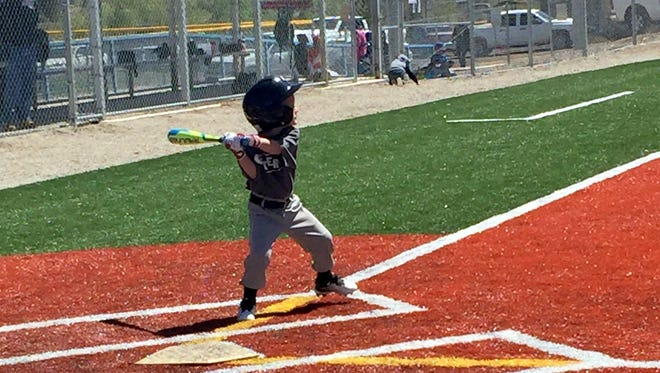 Brennan Ore gets ready to smash a pitch during a game Saturday at Scott Park. He is 4-years old and from Tyrone and plays for Aftershock.