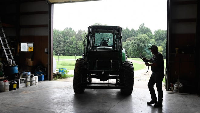 In his farm shop, Henderson County farmer Bob Watson performs maintenance on his equipment to get ready for the approaching harvest season August 18, 2016.