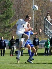 Elmira Notre Dame's Andrew Finnerty heads the ball