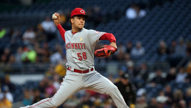 Cincinnati Reds starting pitcher Luis Castillo (58) delivers a pitch against the Pittsburgh Pirates during the first inning.