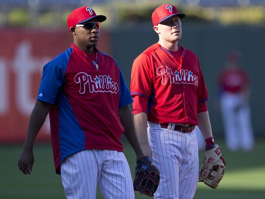 PHILADELPHIA, PA - SEPTEMBER 26: Infielders Maikel Franco #7 and Cody Asche #25 of the Philadelphia Phillies warm up prior to the game against the Atlanta Braves on September 26, 2014 at Citizens Bank Park in Philadelphia, Pennsylvania. (Photo by Mitchell Leff/Getty Images)