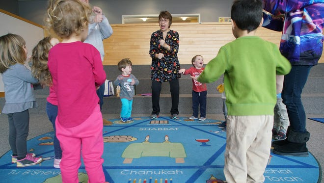 Marla Friedman leads a group of pre-schoolers in a song at the Early Childhood Center located in the Seigel Jewish Community Center on Tuesday morning.