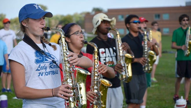 Saxophone players rehearse for Saturday's performance.