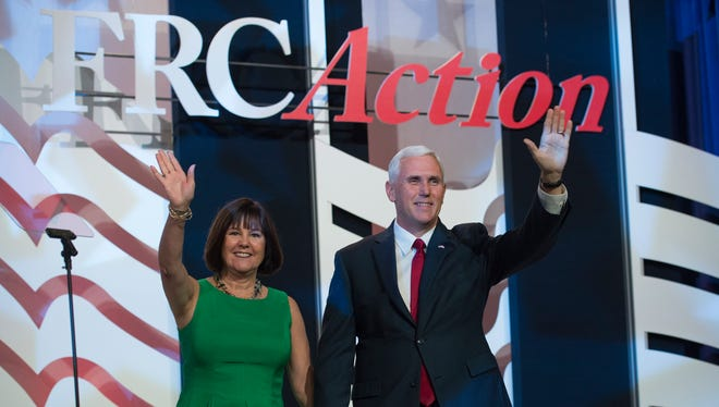 Republican vice presidential candidate Indiana Gov. Mike Pence and his wife Karen take the stage prior to his speaking at the Value Voters Summit in Washington, Saturday, Sept. 10, 2016.