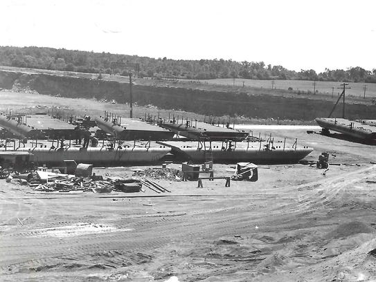 This circa 1940s photo is a view of barges in production,