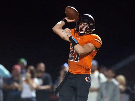 Coalfield quarterback Parker McKinney looks for an