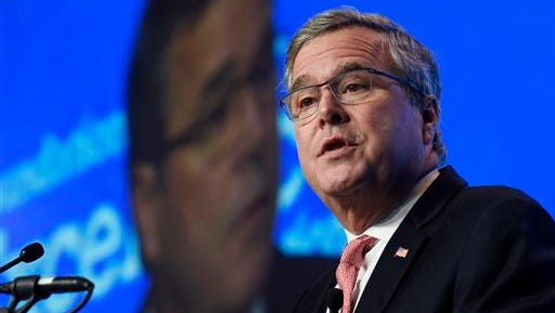 """FILE - In this Nov. 20, 2014, file photo, former Florida Gov. Jeb Bush gives the keynote address at the National Summit on Education Reform in Washington. On Tuesday, Dec. 16, 2014, Bush took his most definitive step yet toward running for president, announcing plans to """"actively explore"""" a campaign and form a new political operation allowing him to raise money for like-minded Republicans. (AP Photo/Susan Walsh, File)"""