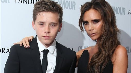 In this file photo, Victoria Beckham and son Brooklyn arrive for the Glamour Women of the Year Awards at Berkeley Square Gardens, London. A clothing spokeswoman said Friday Jan. 16, 2015, Brooklyn Beckham, the oldest son of British soccer star David Beckham and designer Victoria Beckham, will be promoting youth fashion for a Polish clothing brand.