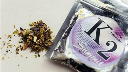 This 2010 file photo, shows a package of K2, which contains herbs and spices sprayed with a synthetic compound chemically similar to THC, the psychoactive ingredient in marijuana. According to the American Association of Poison Control Centers, more than 1,500 people in several states became ill in April 2015 from smoking synthetic marijuana.