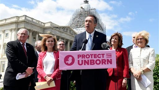 Rep. Trent Franks, R-Ariz., center, speaks during a news conference on the Pain-Capable Unborn Child Protection Act  on Capitol Hill in Washington, Wednesday, May 13, 2015. Republicans predicted House passage Wednesday of the late-term abortion ban after dropping rape provisions that angered female GOP lawmakers and forced party leaders into an embarrassing retreat. Franks is joined by, from left, Rep. Joseph Pitts, R-Pa., Rep. Marcia Blackburn, R-Tenn., Rep. Chris Smith, R-N.J., Rep. Vicky Hartzler, R-Tenn., Rep. Mike Kelly, R-Pa., and Rep. Diane Black, R-Tenn. (AP Photo/Susan Walsh)