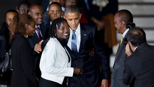 President Barack Obama hugs his half-sister Auma Obama as he arrives at the Jomo Kenyatta International Airport in Nairobi, Kenya Friday, July 24, 2015.  Obama began his first visit to Kenya as U.S. president Friday. (AP Photo/Ben Curtis)