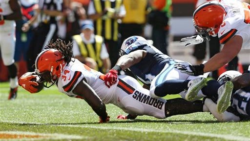 Cleveland Browns running back Isaiah Crowell (34) runs in for an 11-yard touchdown during the first half of an NFL football game against the Tennessee Titans, Sunday, Sept. 20, 2015, in Cleveland. (AP Photo/Ron Schwane)
