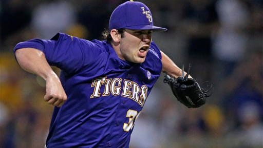 LSU pitcher Alex Lange (35) reacts after retiring the side to end the sixth inning of a game against UNC-Wilmington at the Baton Rouge Regional of the NCAA college baseball tournament in Baton Rouge.