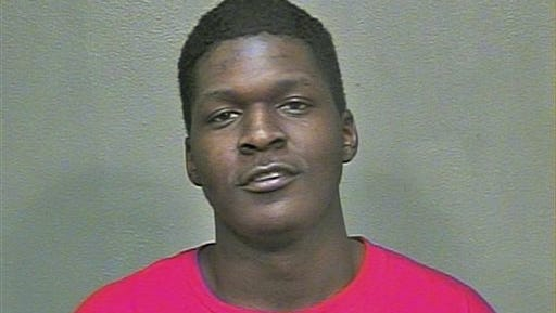 This February 2015 booking photo provided by the Oklahoma County Sheriff's Office shows Quinton Dashawn Laster. The 20-year-old was arrested Tuesday, Feb. 9, 2016, after police found the decapitated bodies of his grandmother, Sharon Reed, 59, and her husband, James Earl Reed, 78, in their Oklahoma City home.